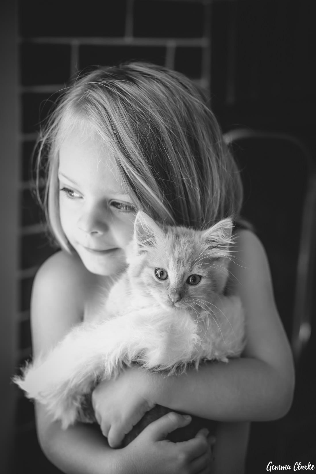 A small girl holding a very cute kitten - 2016 highlights
