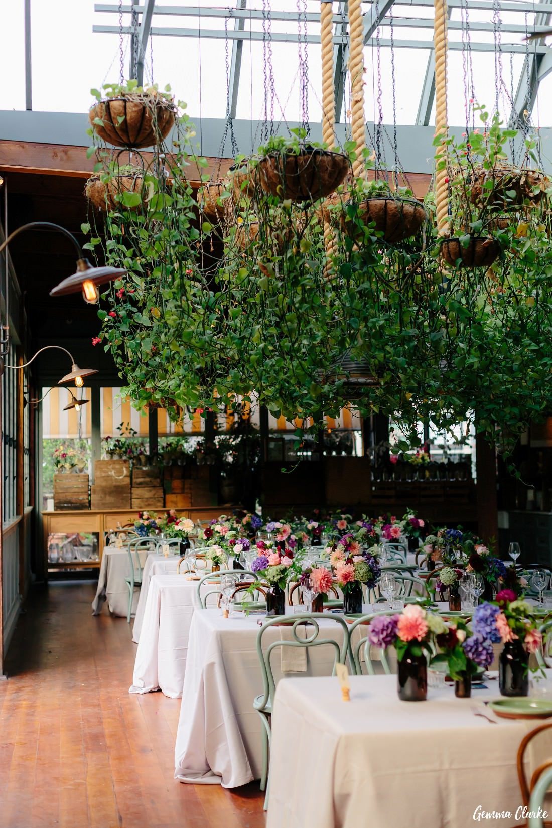 The Atrium decorated with lots of flowers and hanging plants for a Reception at this Grounds of Alexandria Wedding