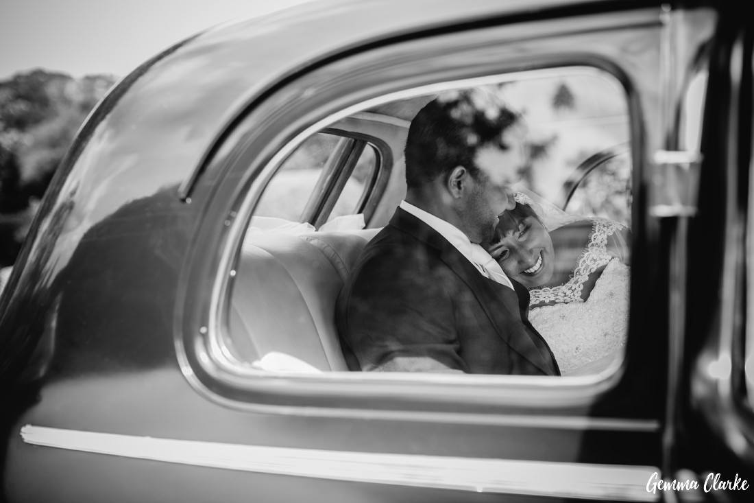 Bride and Groom snuggle in the back seat of a beautiful vintage car at this Peppers Craigieburn Wedding