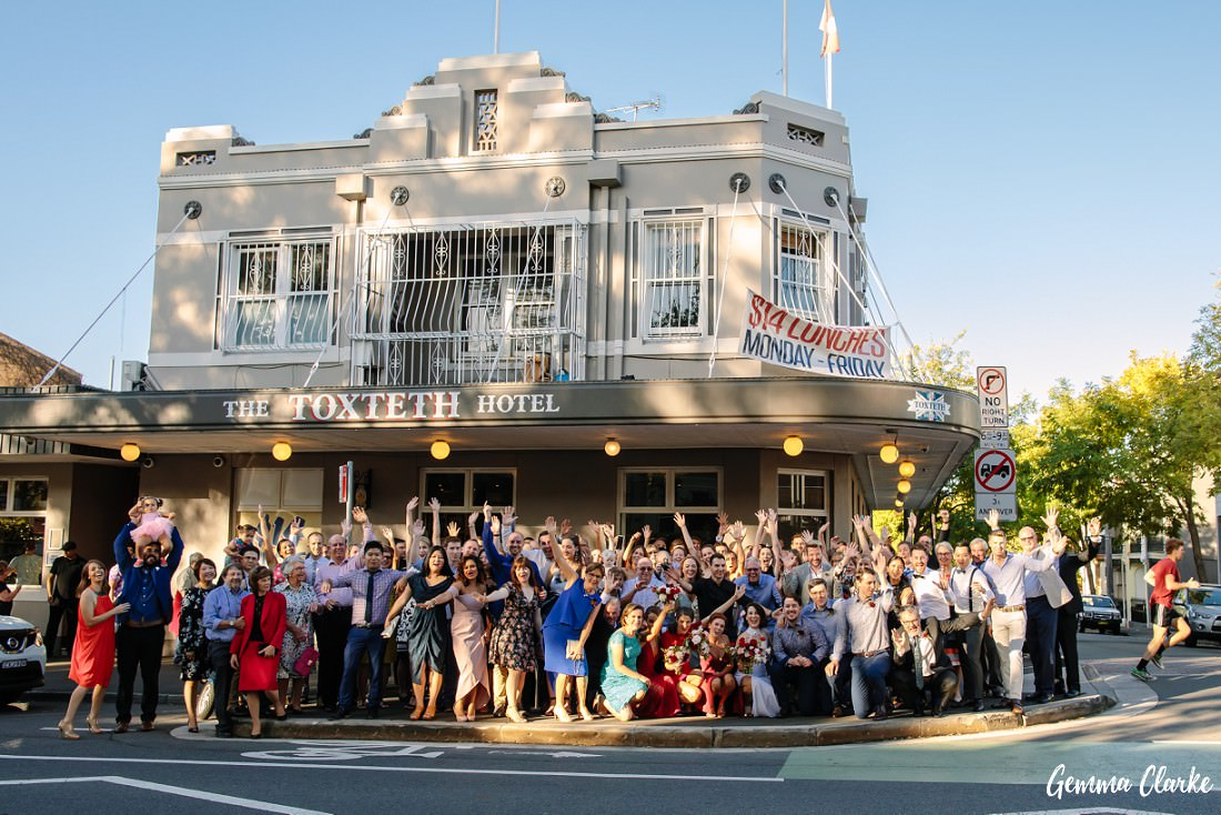 A big group photo of wedding guests outside the Toxteth Hotel at this Sydney Pub Wedding