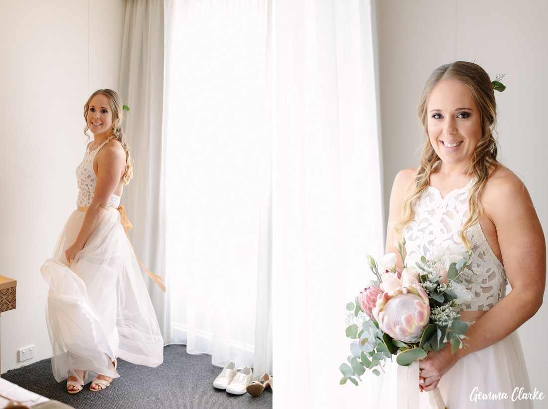 Bride in pink wedding dress by Grace Loves Lace holding a native floral bouquet and dancing around at this Sydney rainy day wedding