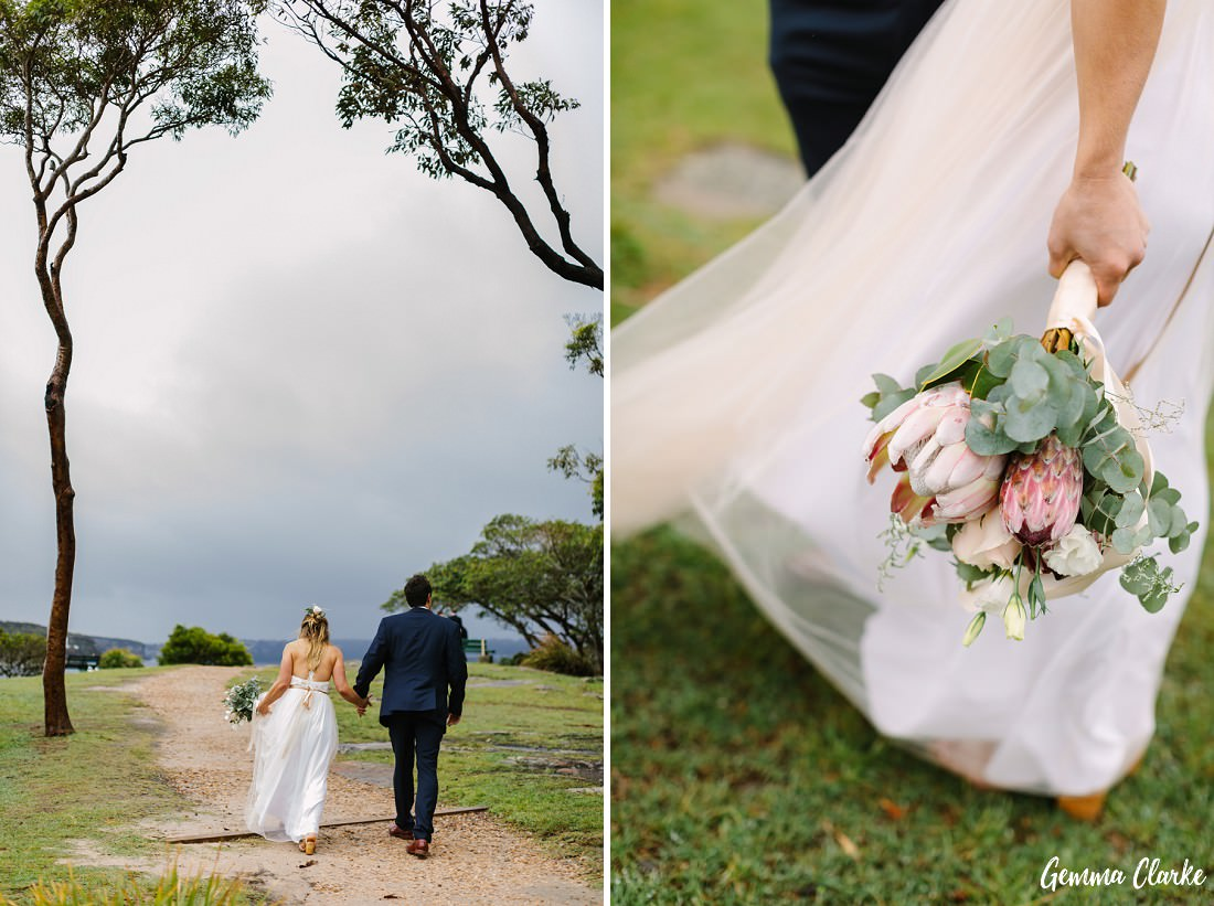 The couple walk into the distance and you can see the storm clouds, there is also a close up of the bouquet in this Sydney rainy day wedding