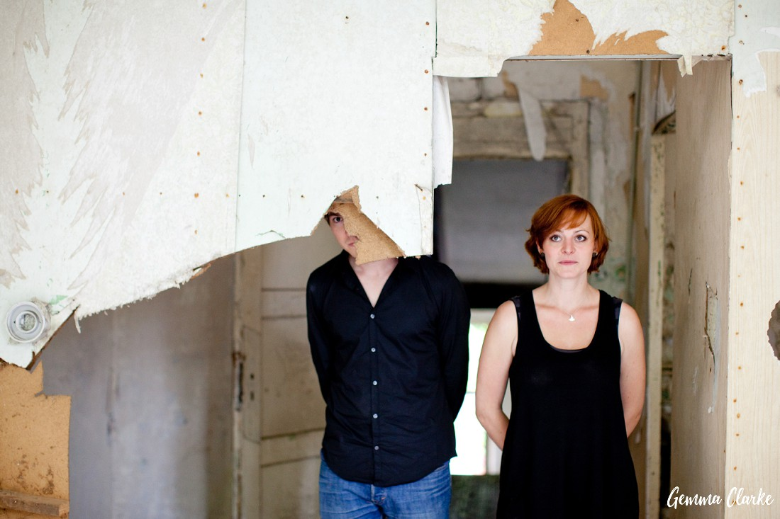 Quirky couple loves to play around with the guy looking from behind a broken part of the wall and the girl looking to the ceiling in these Berlin couple portraits
