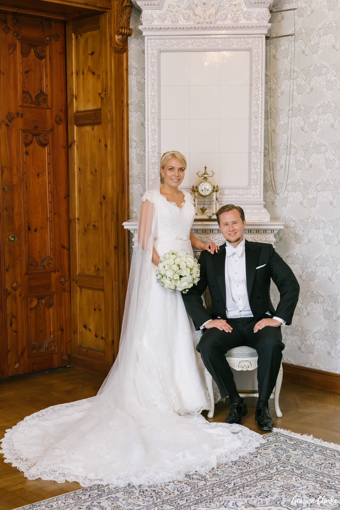 Bride and Groom assume the Swedish Royalty pose in a stunning decorated room at this Tampere Wedding