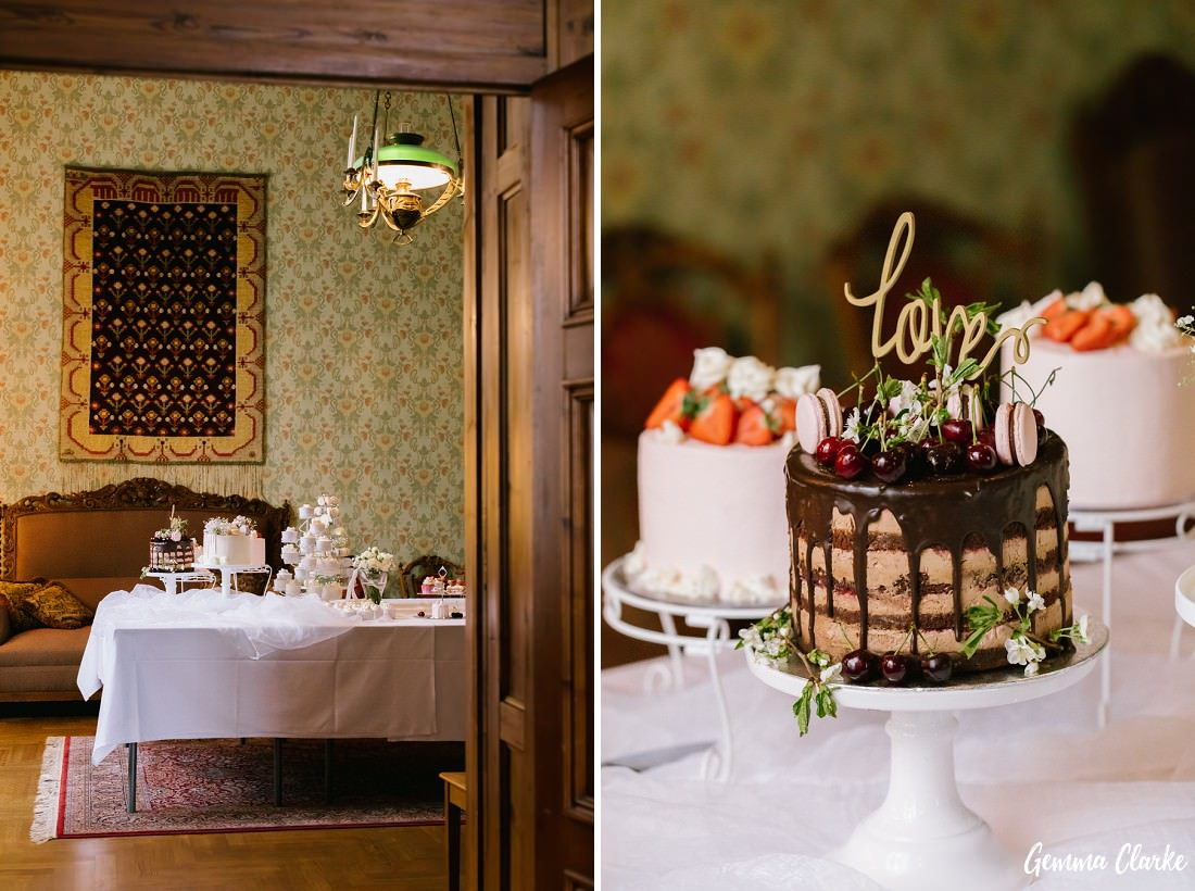 Stunning cakes adorned with chocolate sauce, cherries, strawberries and macroons at this Tampere Wedding