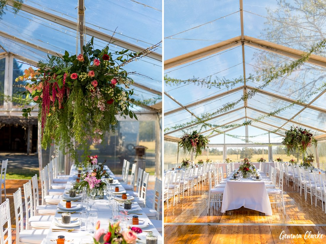 Amazing floral details hanging from the ceiling of a clear marquee the countryside at this Willow Farm Wedding