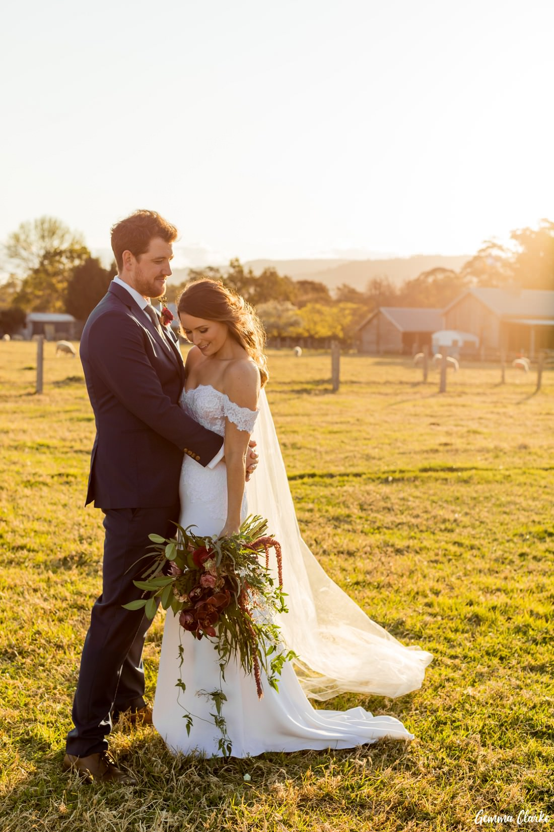 Bride and Groom stand in a country field as the golden sun warms them in their embrace at this Willow Farm Wedding