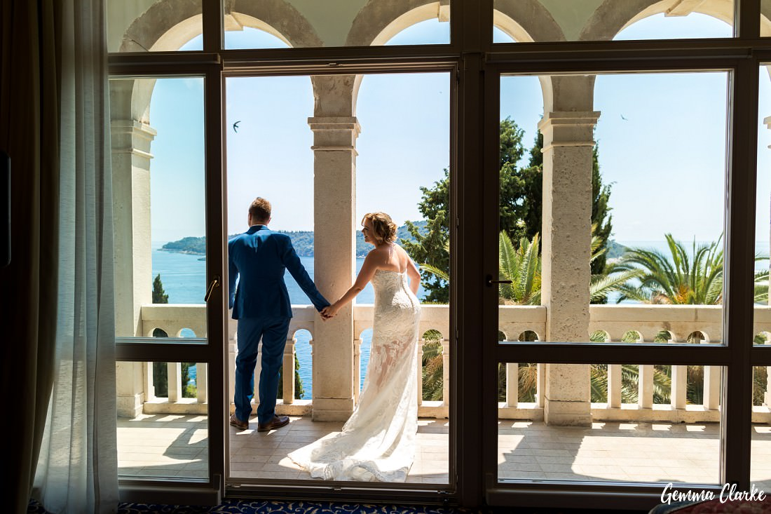 The First non-look between a bride and groom. They just hold hands by the balcony at this Dubrovnik Destination Wedding