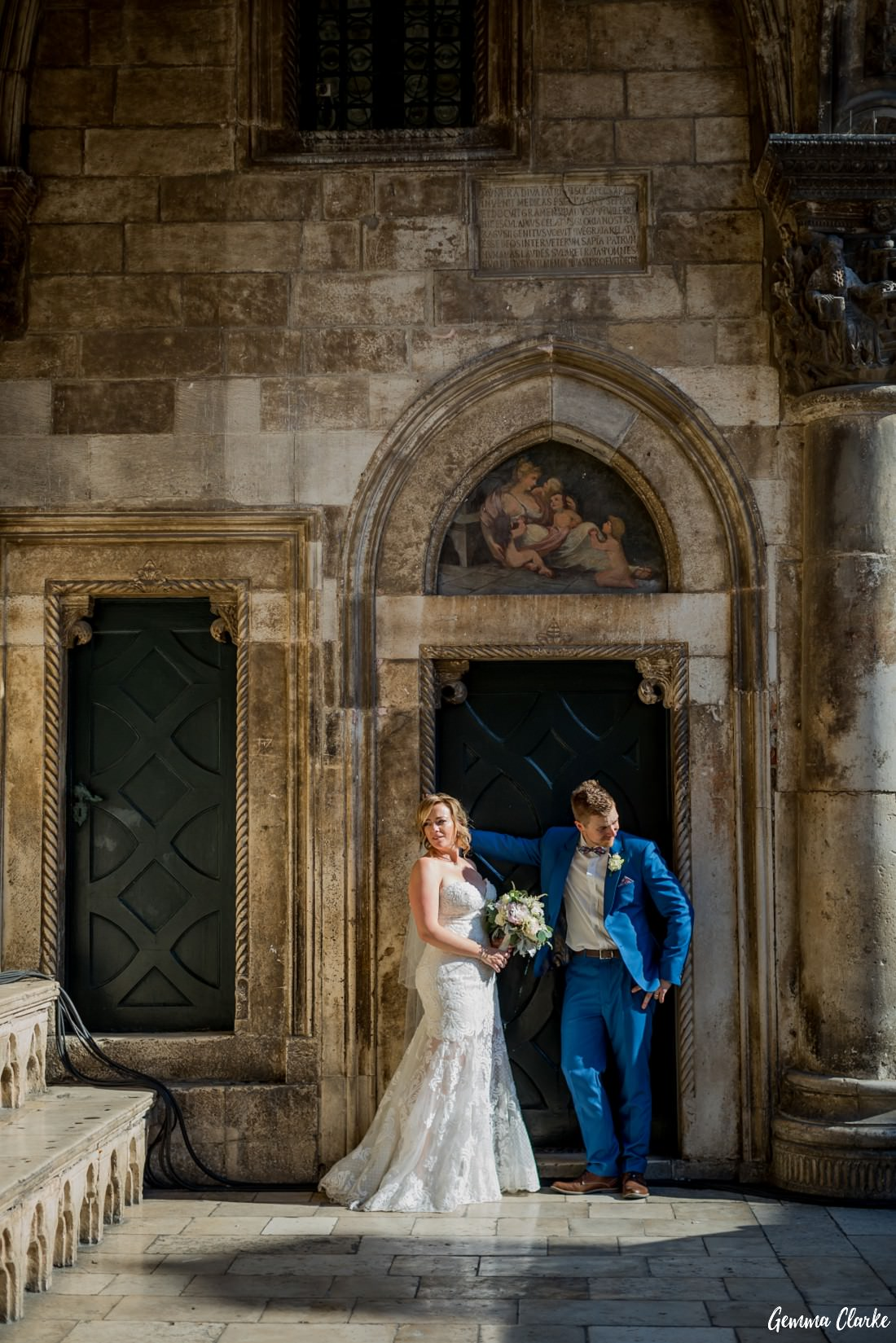 Couple stand like models out the front of the character rich Rector's Palace at this Dubrovnik Destination Wedding