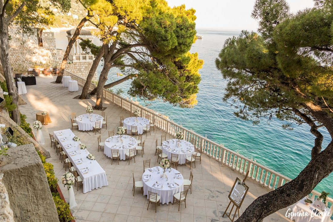 The reception terrace is set out beautifully with white tablecloths and overlooking the Adriatic Sea at this Dubrovnik Destination Wedding