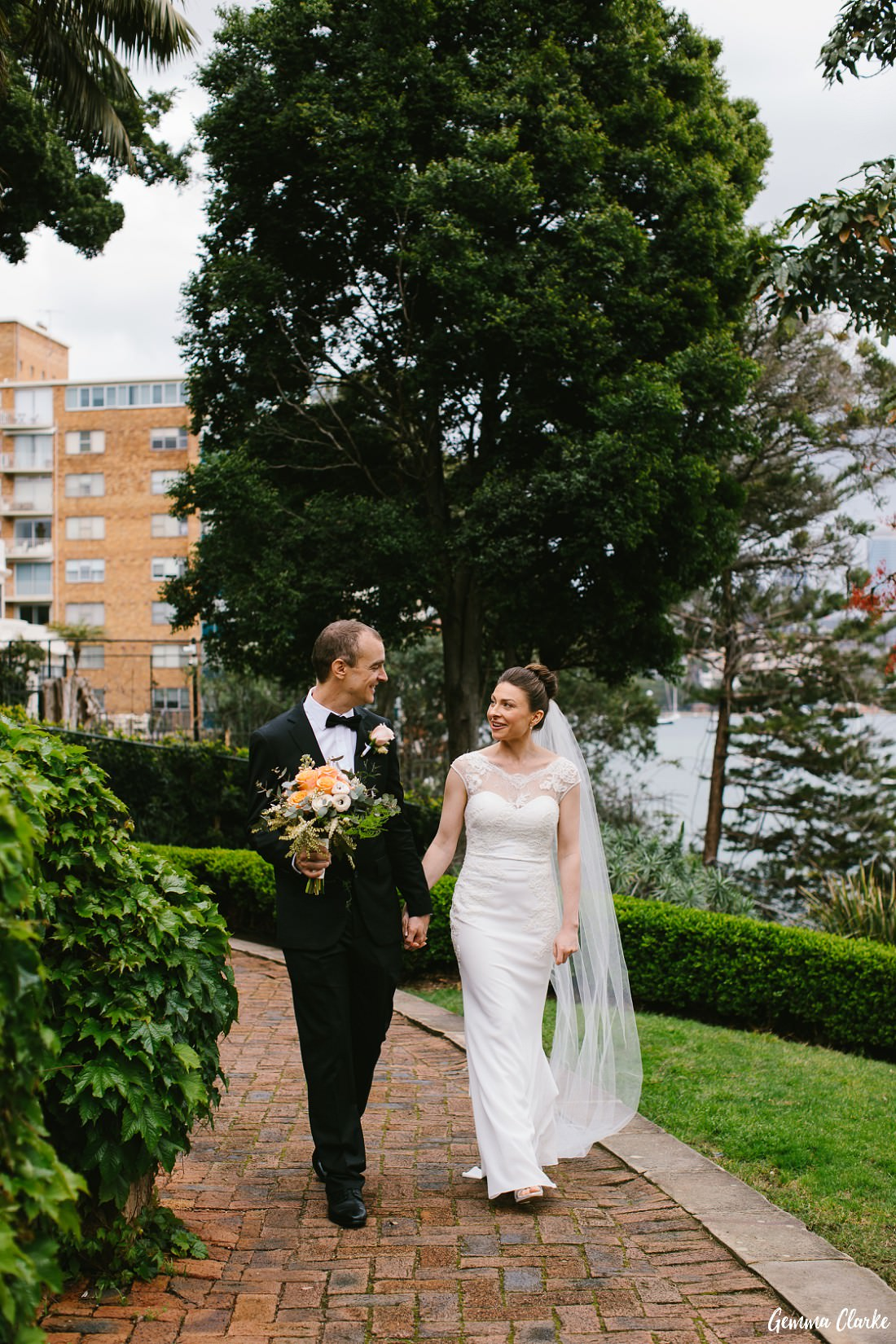 Wedding couple walk a path at McKell Park looking very happy at this small wedding Sydney