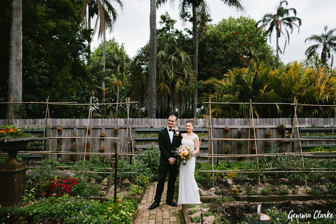 Bride and Groom stand in the Chiswick Restaurant vegetable and flower garden for their small wedding sydney