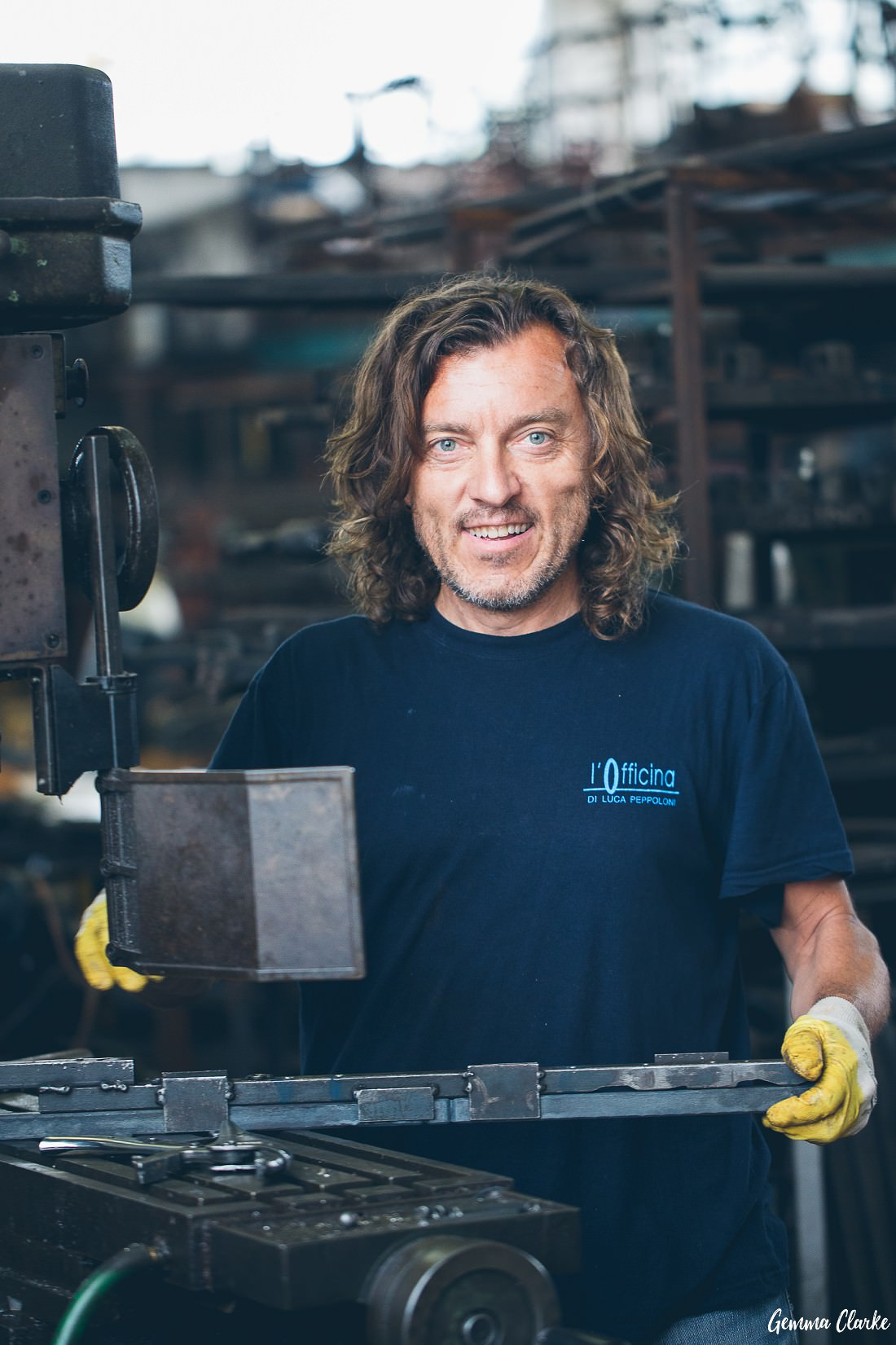 Blacksmith Luca Peppoloni works on a machine in these Small Business Lifestyle Portraits