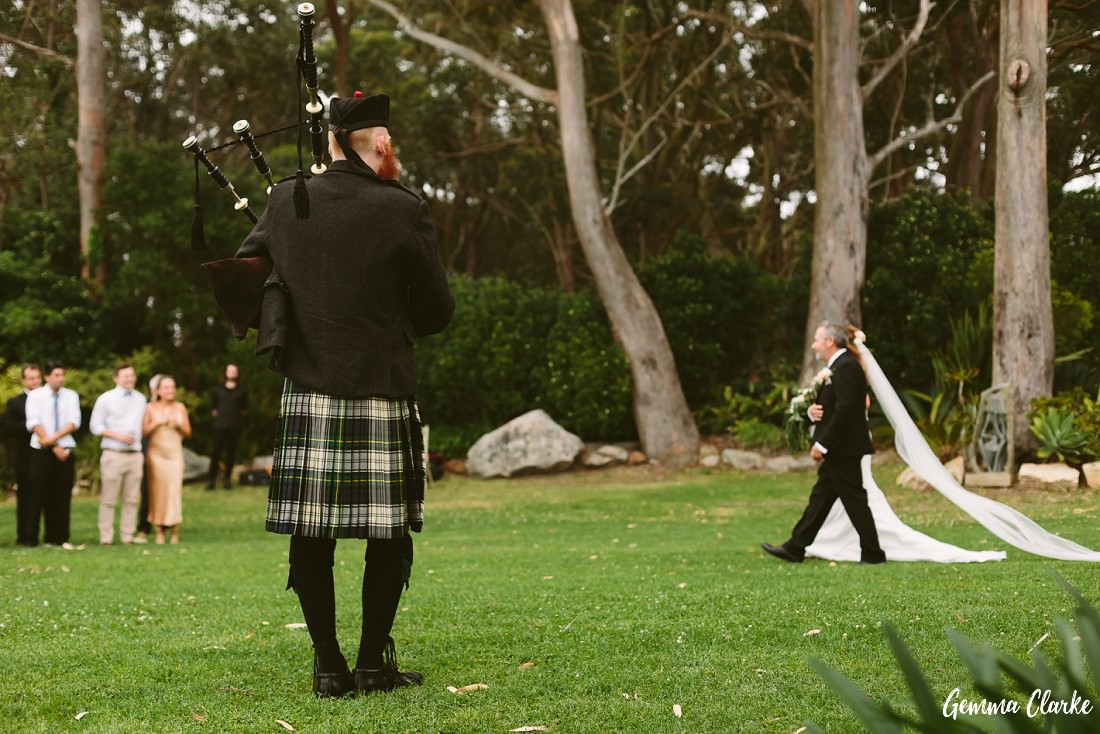 Scottish Bagpiper at this Stanwell Tops Wedding welcomes the bride down the aisle
