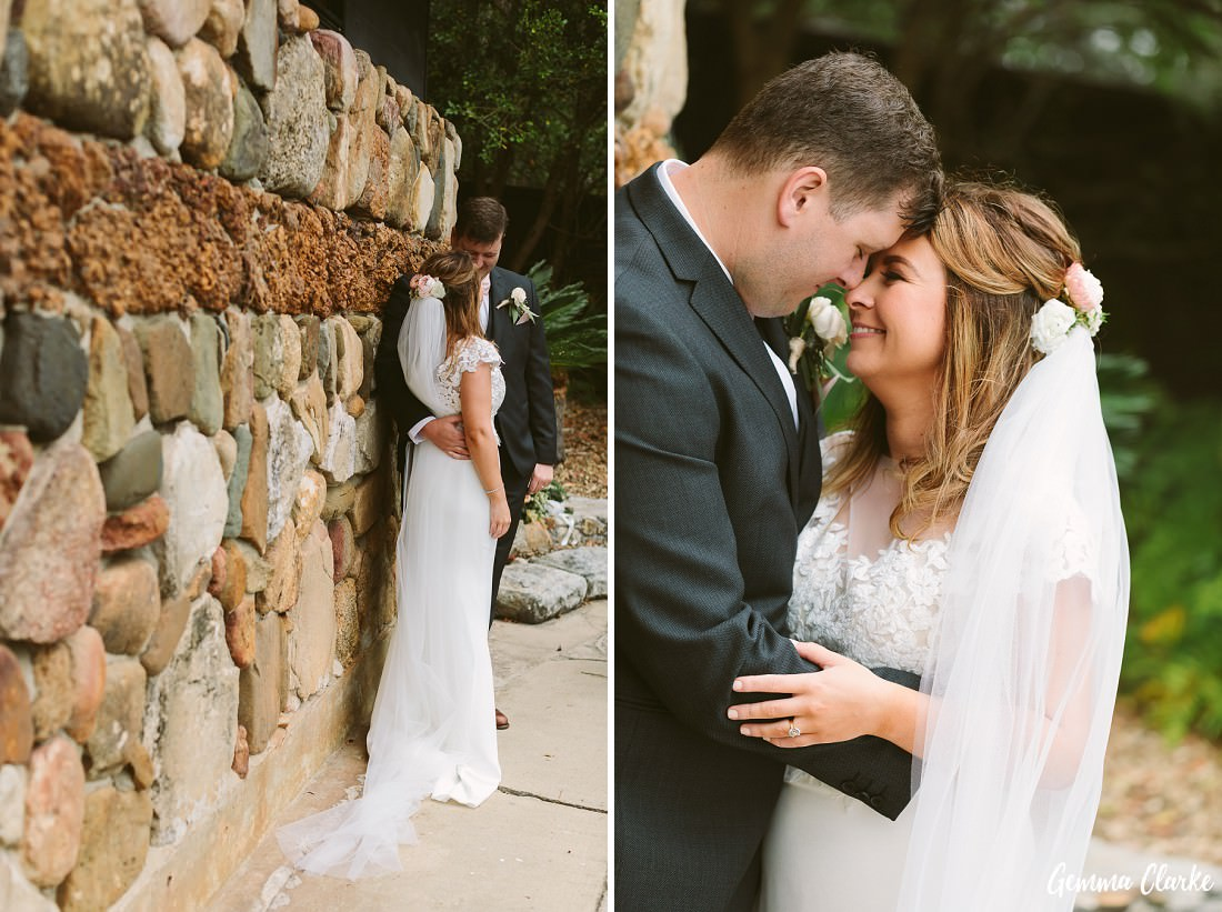 Couple snuggles by the sandstone pool house at this Stanwell Tops Wedding
