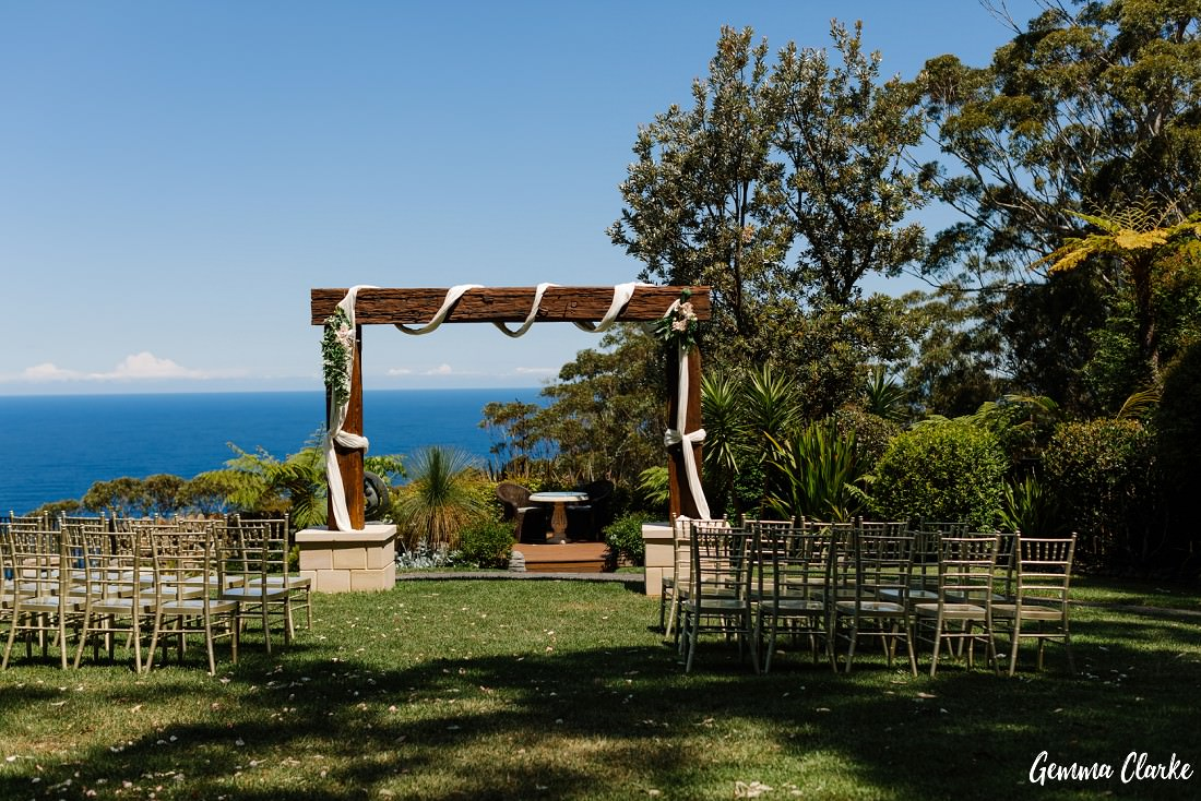 Gorgeous decorated arbour with ceremony set up and gold Tiffany chairs at this Tumbling Waters Retreat Wedding