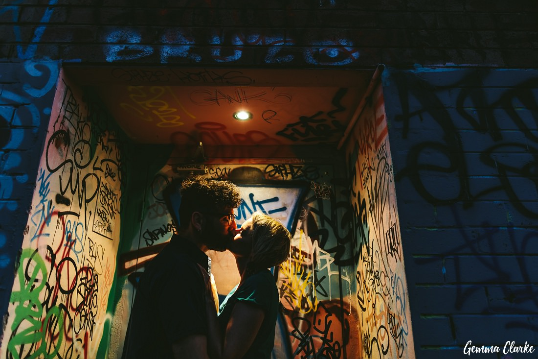 Kissing couple in a graffiti filled alcove at these Newtown Couple Portraits