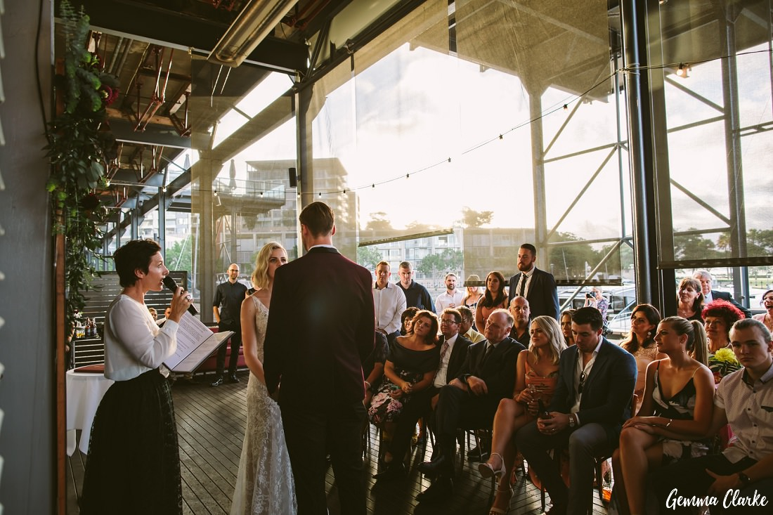 Vows are exchanged as the sun goes down at this Cafe Morso Wedding in Pyrmont.