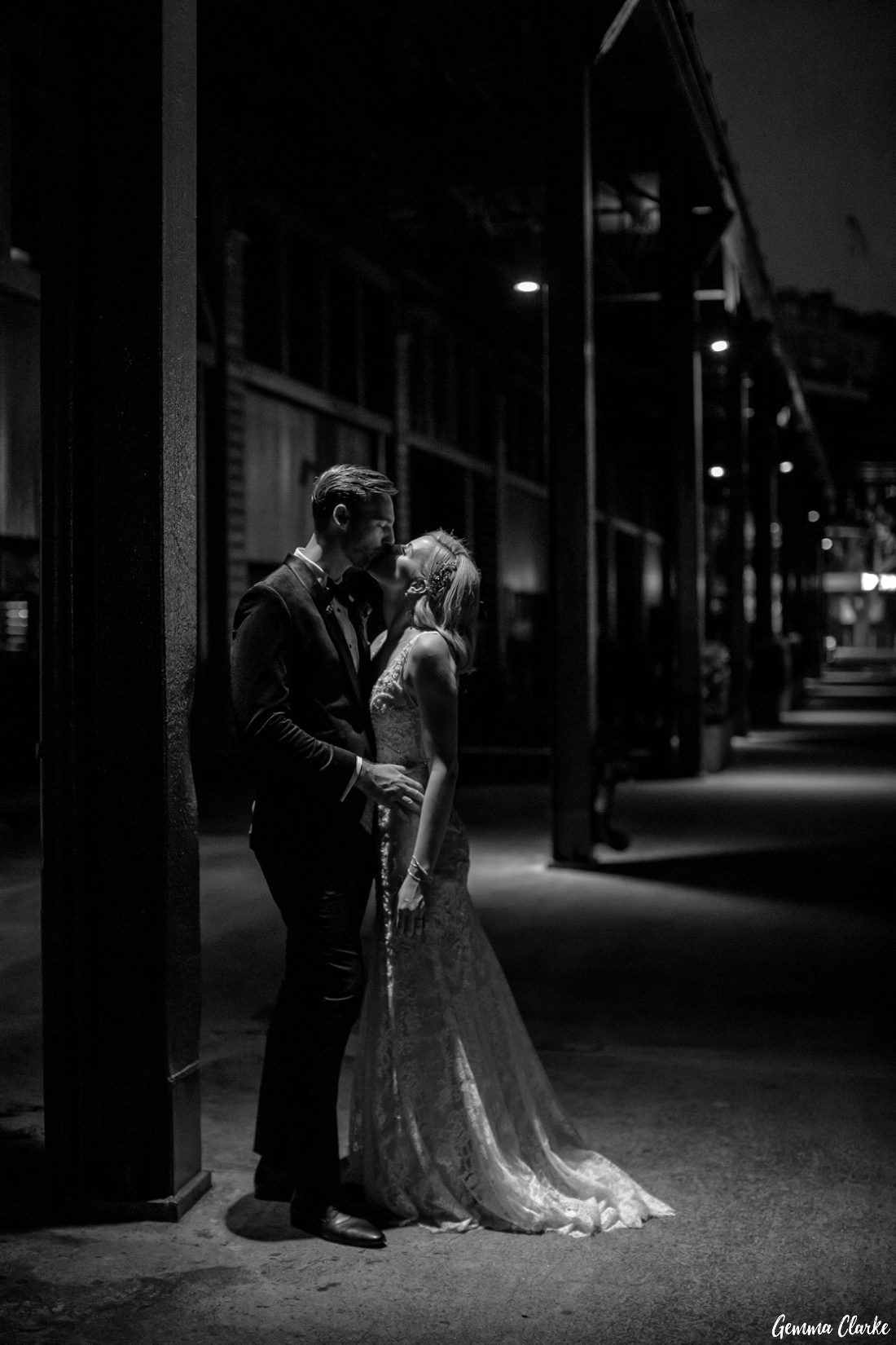 Moody feel to this capture of the bride and groom at night with the wharf warehouses in the background at this Cafe Morso Wedding