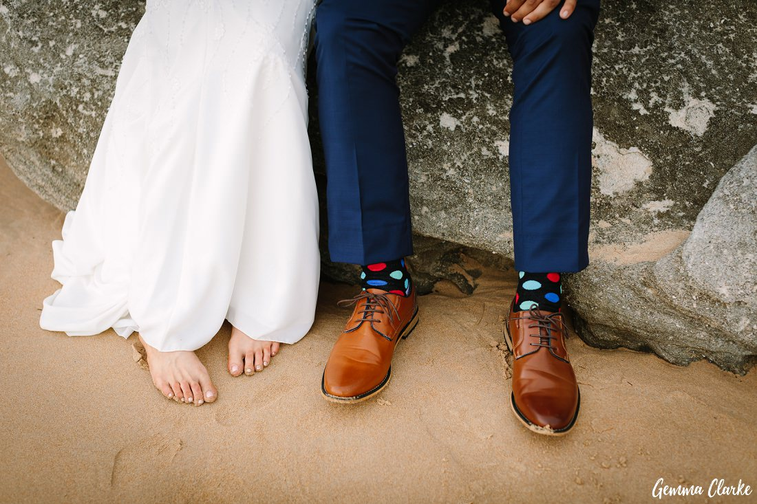 Colourful sock, shoes and bare feet on the beach at this Freshwater Wedding in Sydney