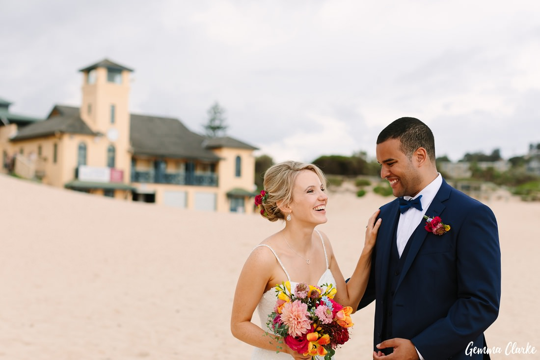 Patrick and Charlotte having a good laugh at their Freshwater Wedding in front of the Surf lifesaving Club