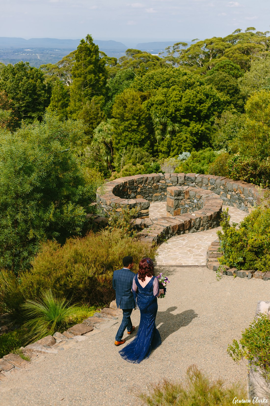 Cherie heads down toward the ceremony with her son on her arm at this Mount Tomah Botanic Gardens Wedding