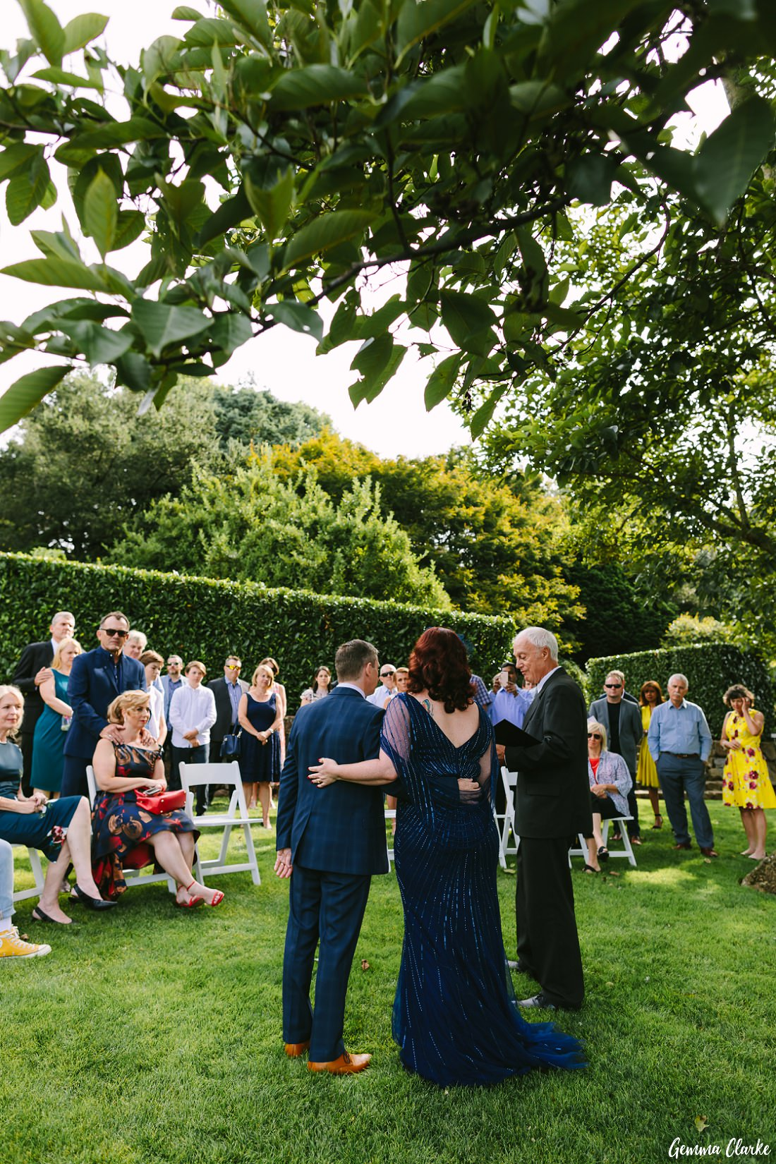 Under a big beautiful tree and amongst the hedges the guests enjoy this heartfelt ceremony at this Mount Tomah Botanic Gardens Wedding.