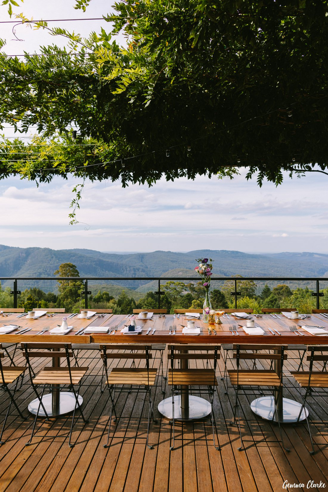 Amazing balcony dining with overhead vines at The Potager at this Mount Tomah Botanic Gardens Wedding