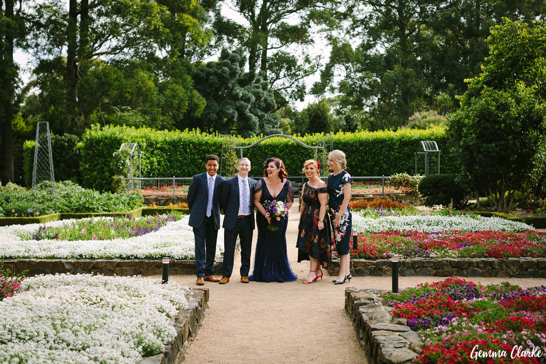 Cherie and Jock with their relaxed bridal party amongst the colourful flowers at their Mount Tomah Botanic Gardens Wedding