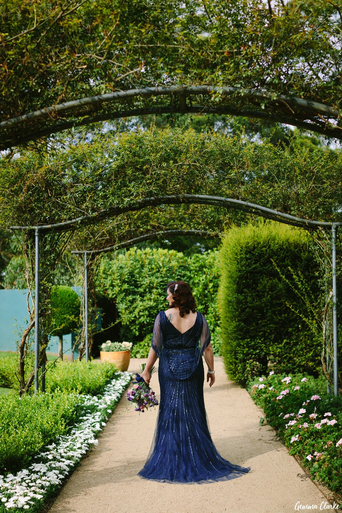 Cherie showing off her amazing blue wedding dress amongst the arches and flowers at her Mount Tomah Botanic Gardens Wedding