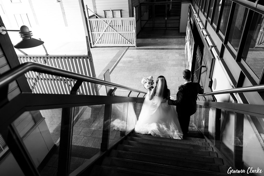 Olga and Allan heading out for some photos on the wharf at their Ovolo Hotel Wedding