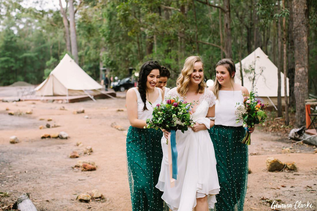 The bridesmaids help the bride to the rock cathedral at this Kangaroo Valley Winter Wedding