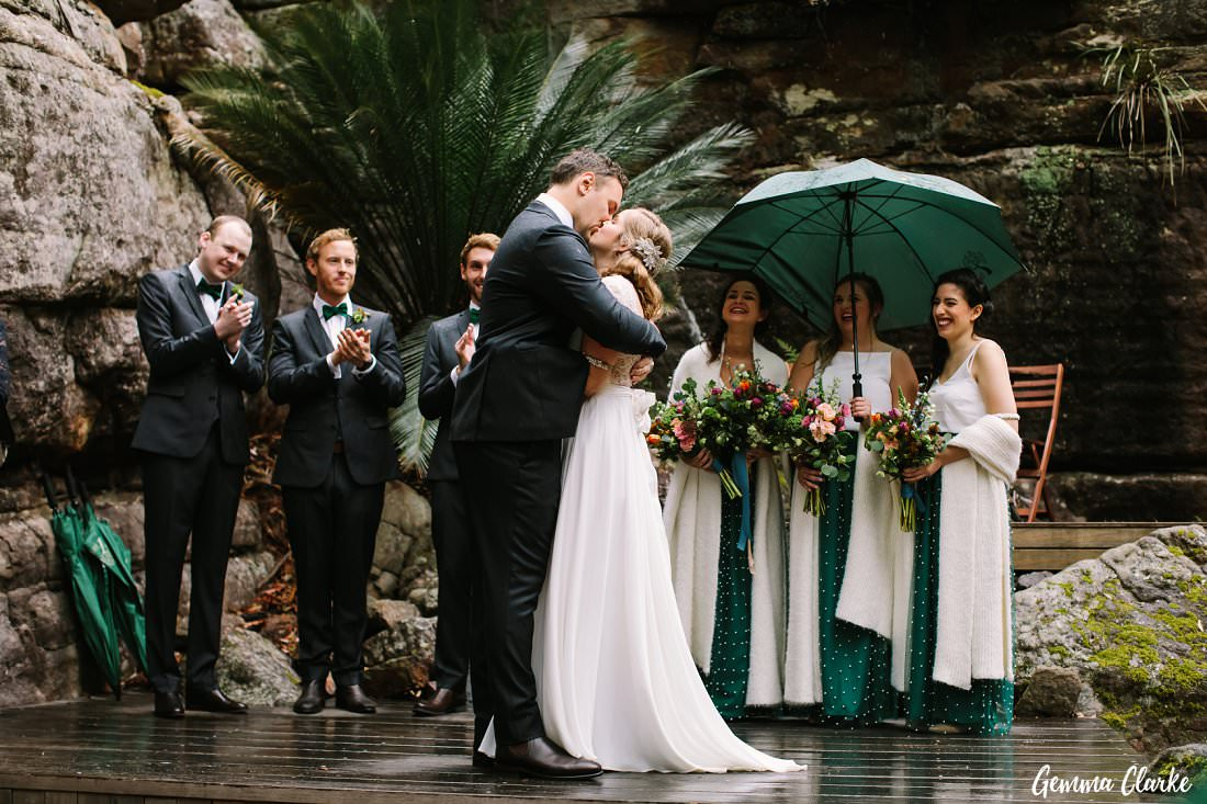 The first kiss in the rain was so romantic for Jessie and Harrison at their Kangaroo Valley Winter Wedding