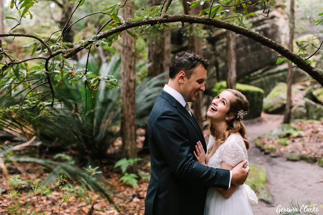 Pure joy as they cuddle together in the rain at their Kangaroo Valley Winter Wedding