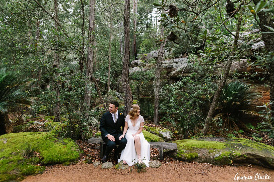 Jessie and Harrison check out the beautiful bush and green moss surrounding them at their Kangaroo Valley Winter Wedding