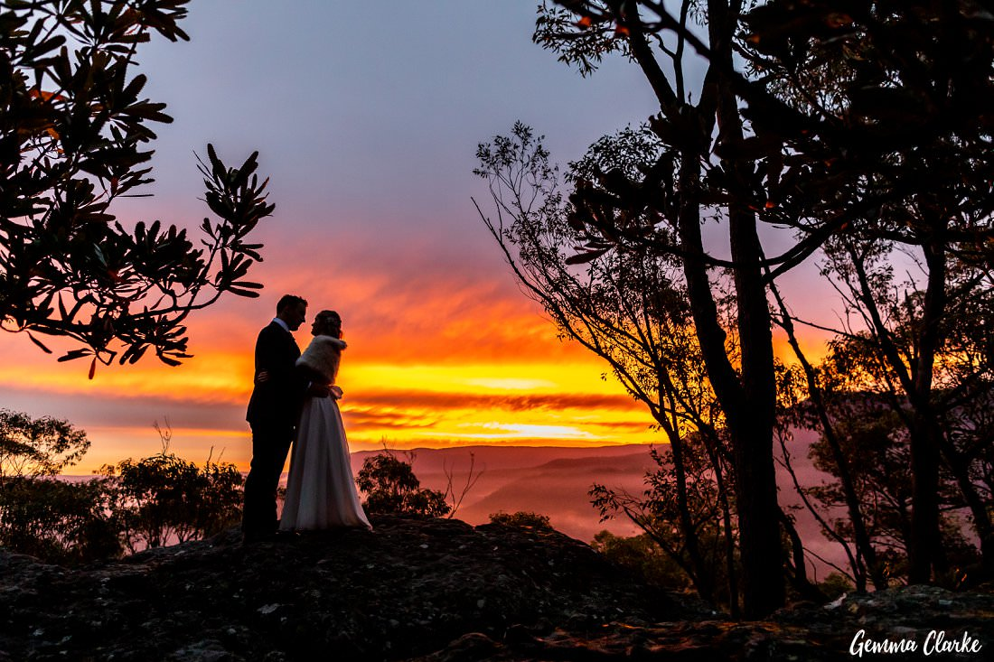Bride and Groom stand on the rock enjoying the sunset at this Kangaroo Valley Bush Wedding