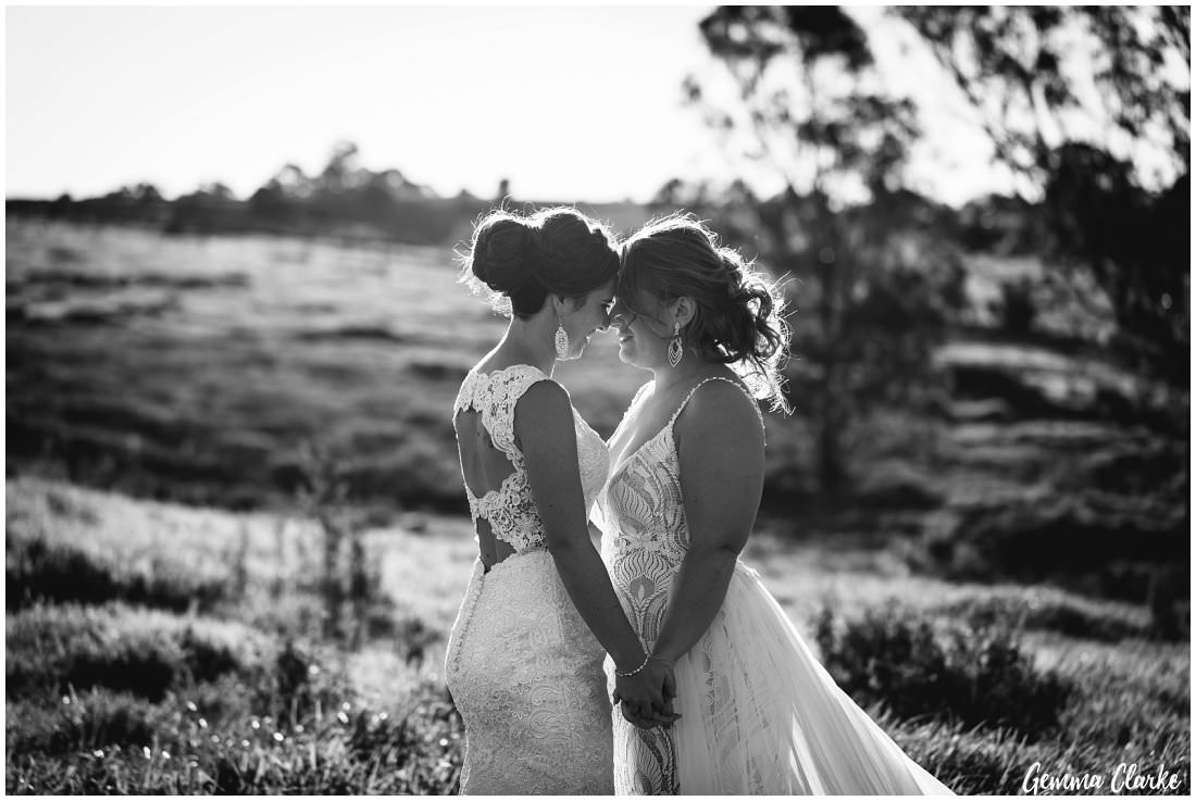 A quiet moment for two brides as they take in the peacefulness on top of the hill at their Ottimo House Wedding
