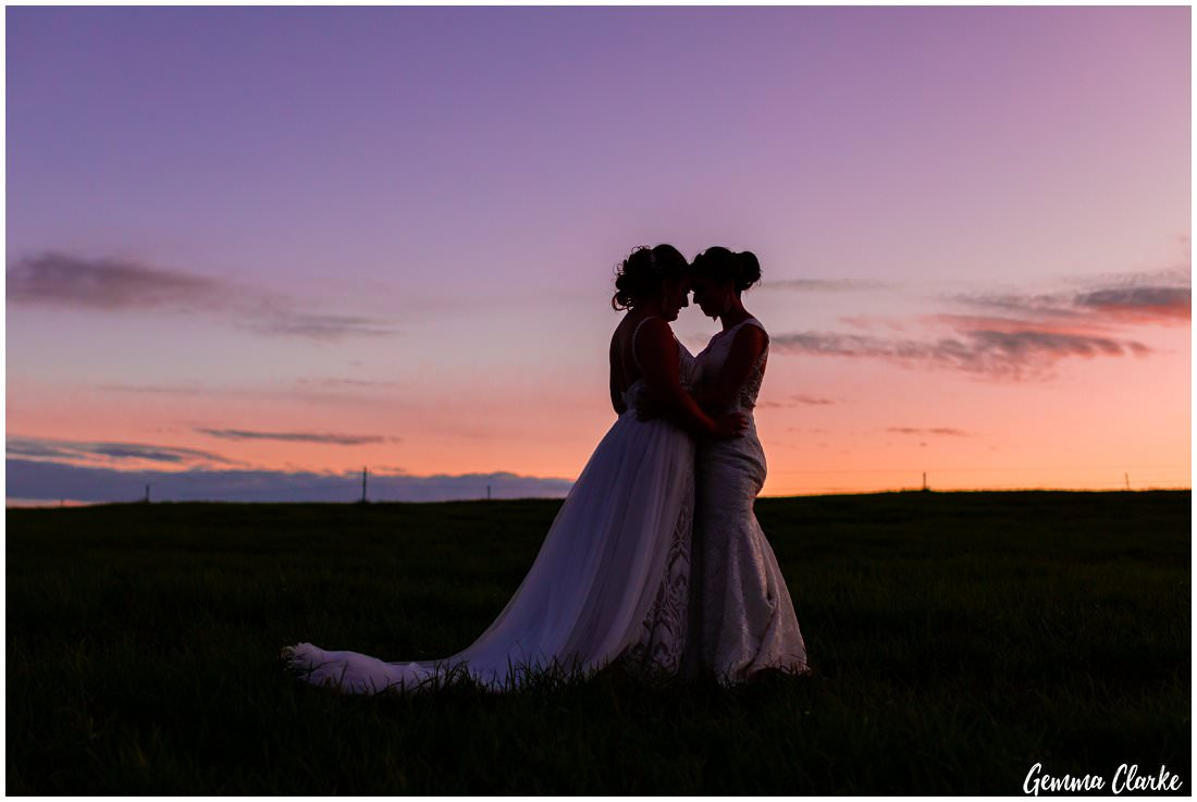 Two brides and a three colour sunset - pinks, oranges and purples at their Ottimo House Wedding