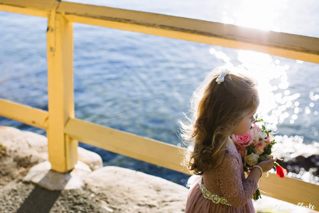 Deep contemplation for this sweet flower girl by the water at her parent's Manly Yacht Club Wedding