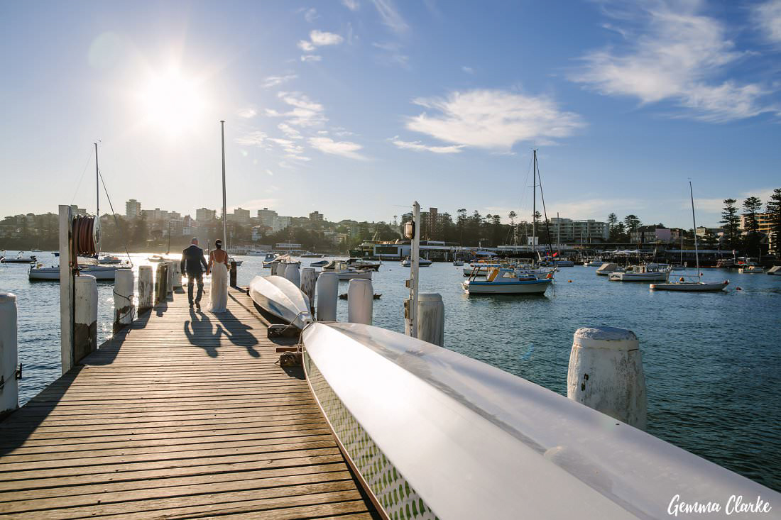 Naomi and Mark heading out to the end of the wharf on an absolutely stunning autumn day at their Manly Yacht Club Wedding