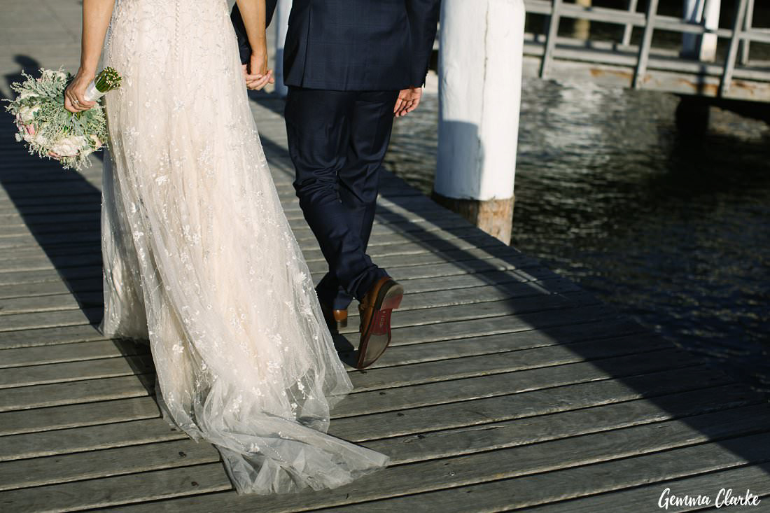 The details of Naomi's beautiful dress as they walk back to the celebrations at their Manly Yacht Club Wedding