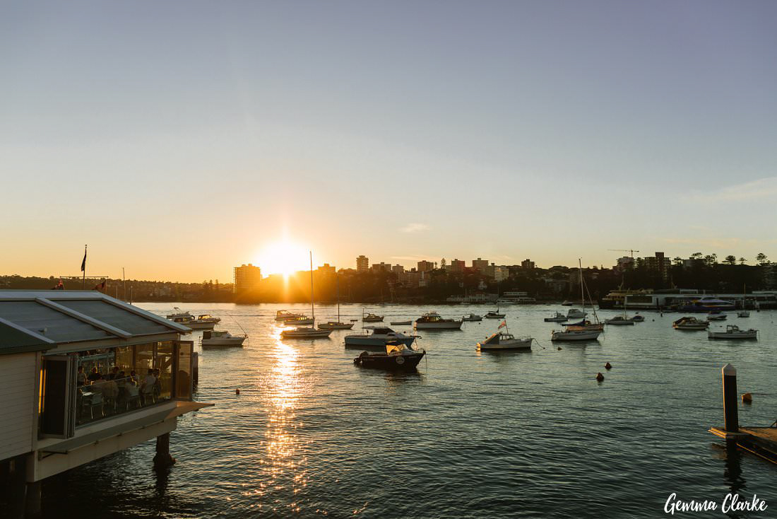 The sun setting over the water at this Manly Yacht Club Wedding