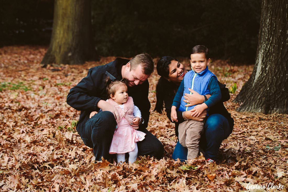 A young family enjoying their time among the leaves at this Parramatta Park family portraits session