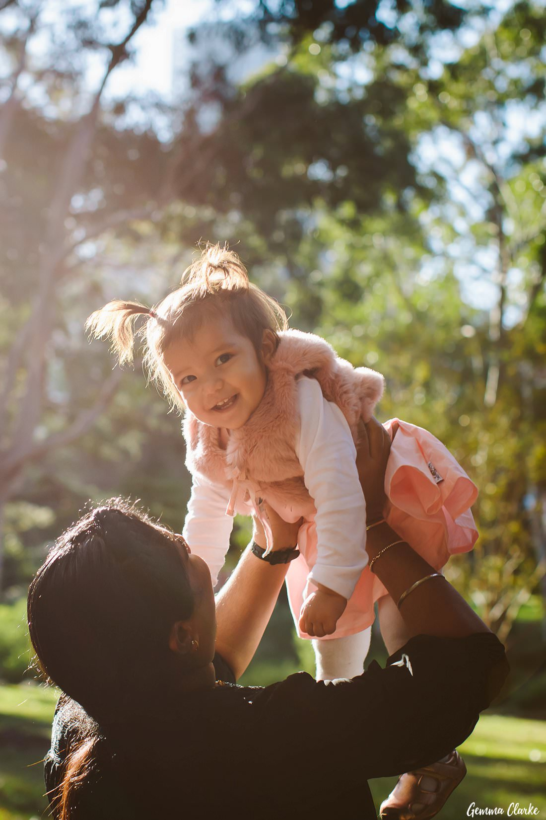 Big smiles for this cutie while she is thrown in the air at this Parramatta Park family portraits session!
