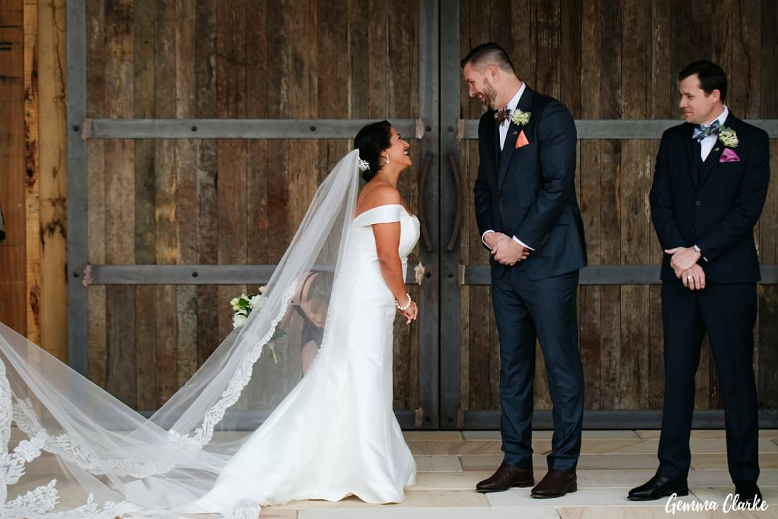 The bride and groom so excited to see each other at the end of the aisle at The Stables Wedding