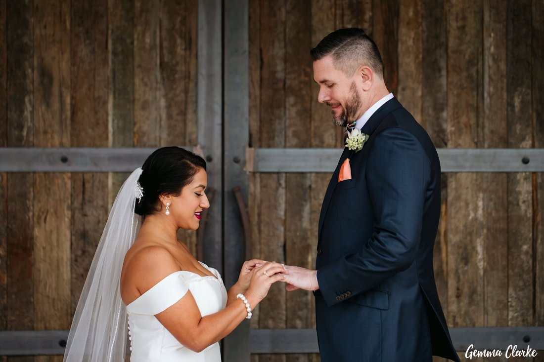 Exchanging of rings during the ceremony at The Stables Wedding at Bendooley Estate
