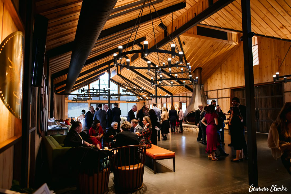 A very toasty mingling area for guests at The Stables Wedding at Bendooley Estate