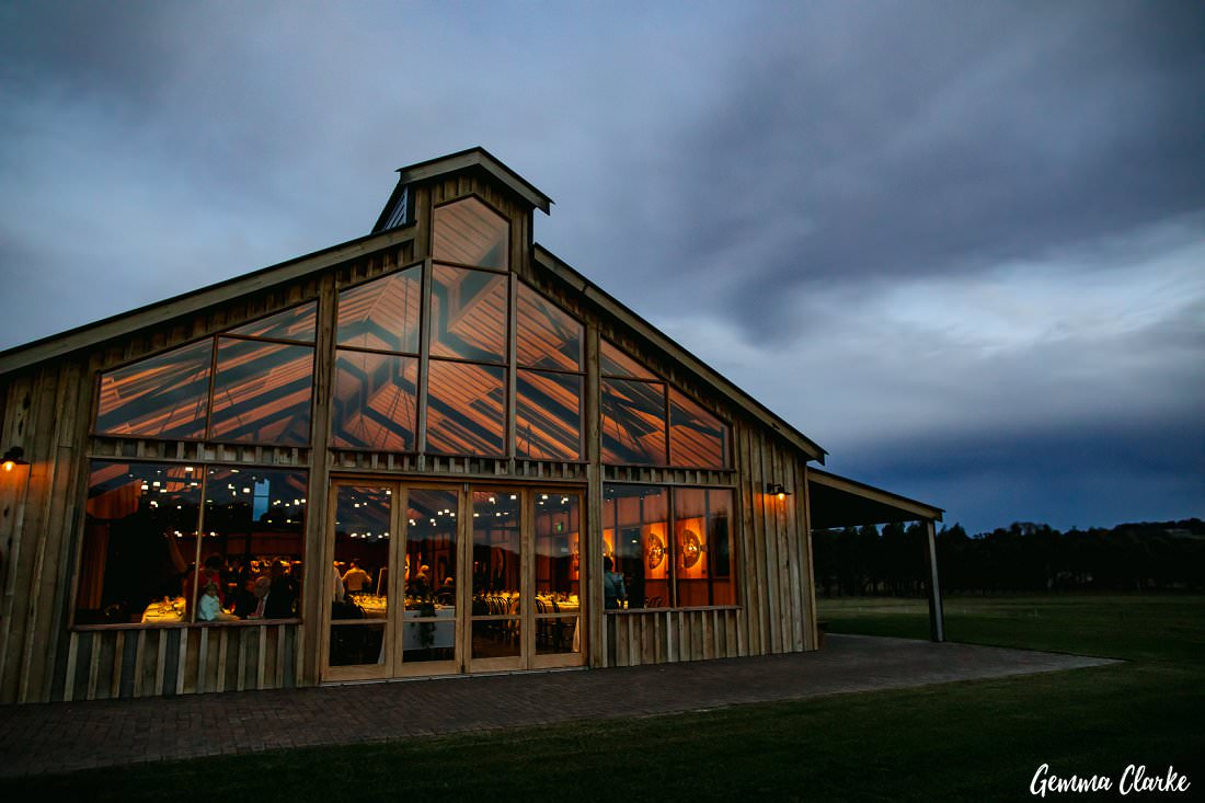 The Stables Wedding reception barn as the sun sets on an overcast day