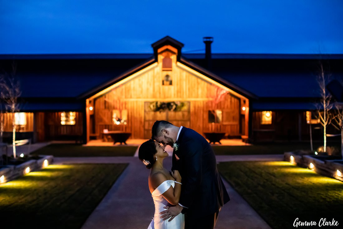 Stunning night capture of the bride and groom in front of The Stable Wedding venue at Bendooley Estate