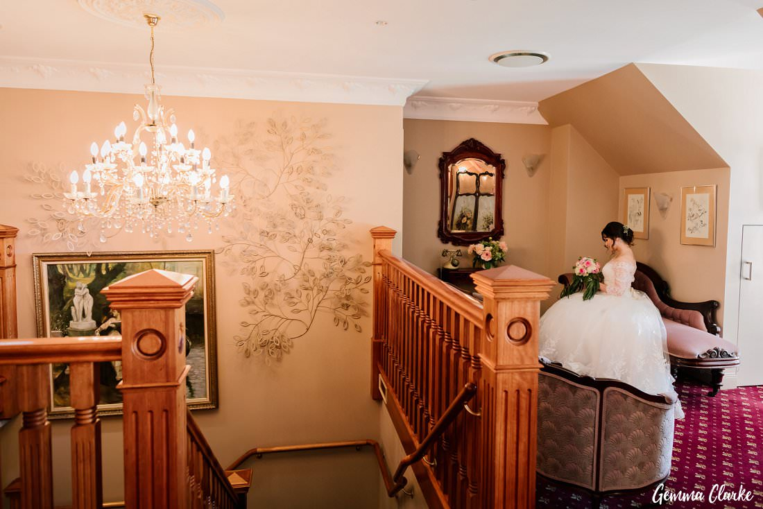 A bride ready and waiting and looking stunning in the gorgeous setting at her Gardens on Forest Wedding